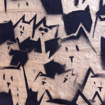 Simple but stunning cat portraits on wallpaper, glued on a wall in Rotterdam, the Netherlands.