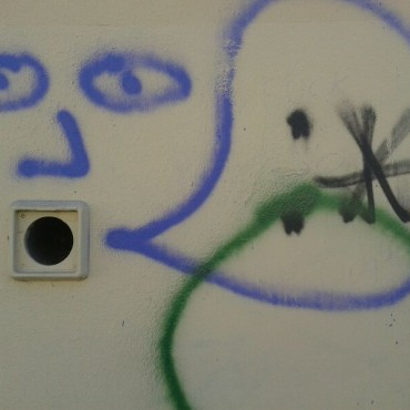 Wall socket becomes mouth of character.